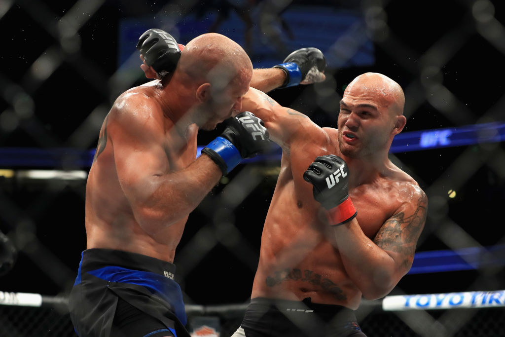 ANAHEIM, CA - JULY 29:  <a href='../fighter/Robbie-Lawler'>Robbie Lawler</a> (black shorts) fights <a href='../fighter/Donald-Cerrone'>Donald Cerrone</a> during their Welterweight bout at UFC 214 at Honda Center on July 29, 2017 in Anaheim, California.  (Photo by Sean M. Haffey/Getty Images)