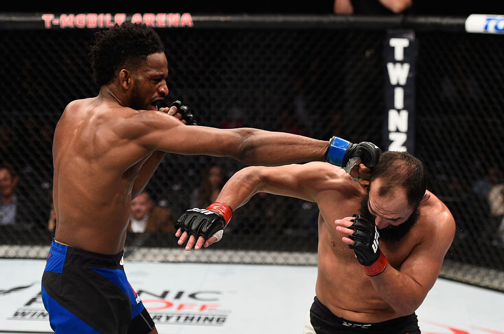LAS VEGAS, NV - DECEMBER 30: (L-R) Neil Magny punches <a href='../fighter/Johny-Hendricks'>Johny Hendricks</a> in their welterweight bout during the UFC 207 event at T-Mobile Arena on December 30, 2016 in Las Vegas, Nevada.  (Photo by Jeff Bottari/Zuffa LLC)