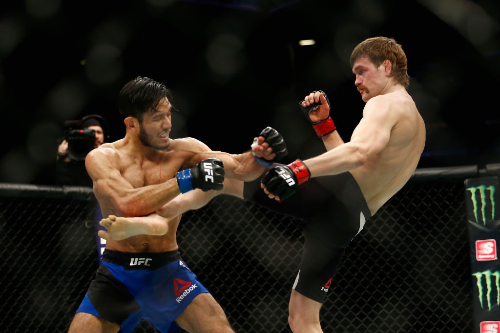 NEW YORK, NY - FEBRUARY 11: <a href='../fighter/rick-glenn'>Rick Glenn</a> (R) of United States lands a kick against <a href='../fighter/Phillipe-Nover'>Phillipe Nover</a> (L) of United States in their featherweight bout during UFC 208 at the Barclays Center on February 11, 2017 in the Brooklyn Borough of New York City.  (Photo by Anthony Geathers/Getty Images)