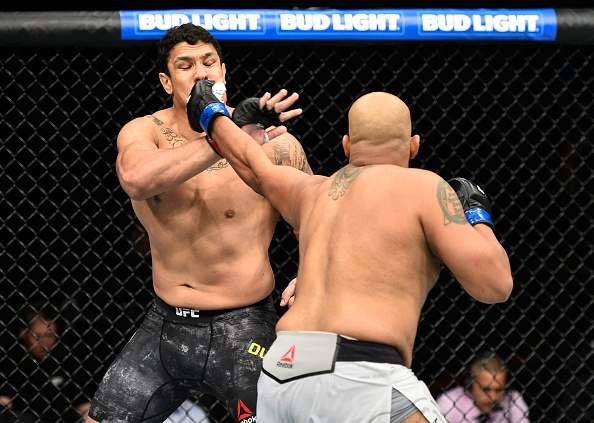 EDMONTON, AB - SEPTEMBER 09:  (R-L) Arjan Singh Bhullar of Canada punches Luis Henrique of Brazil in their heavyweight bout during the UFC 215 event inside the Rogers Place on September 9, 2017 in Edmonton, Alberta, Canada. (Photo by Jeff Bottari/Zuffa LLC/Zuffa LLC via Getty Images)
