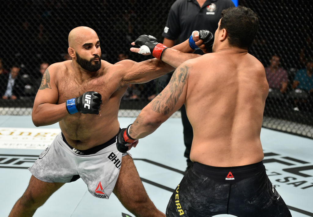 EDMONTON, AB - SEPTEMBER 09:  (L-R) <a href='../fighter/Arjan-Bhullar'>Arjan Singh Bhullar</a> of Canada punches <a href='../fighter/luis-henrique'>Luis Henrique</a> of Brazil in their heavyweight bout during the UFC 215 event inside the Rogers Place on September 9, 2017 in Edmonton, Alberta, Canada. (Photo by Jeff Bottari/Zuffa LLC)