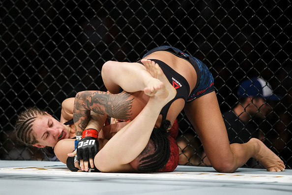 "EDMONTON, AB - SEPTEMBER 09:  Sarah Moras, left, fights Ashley Evans-Smith during UFC 215 at Rogers Place on September 9, 2017 in Edmonton, Canada. (Photo by Codie McLachlan/Getty Images)"" align="