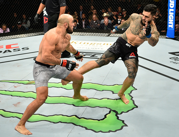 EDMONTON, AB - SEPTEMBER 09:  (R-L) Tyson Pedro of Australia kicks Ilir Latifi of Sweden in their light heavyweight bout during the UFC 215 event inside the Rogers Place on September 9, 2017 in Edmonton, Alberta, Canada. (Photo by Jeff Bottari/Zuffa LLC/Zuffa LLC via Getty Images)