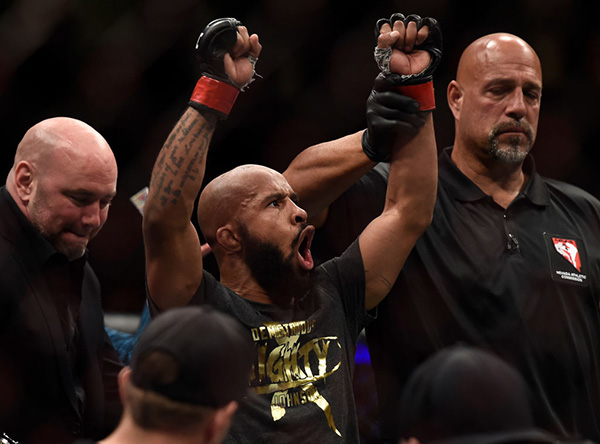 <a href='../fighter/Demetrious-Johnson'>Demetrious Johnson</a> celebrates after his submission victory over <a href='../fighter/Ray-Borg'>Ray Borg</a> in their UFC flyweight championship bout during the UFC 216 event inside T-Mobile Arena on October 7, 2017 in Las Vegas, Nevada. (Photo by Brandon Magnus/Zuffa LLC)
