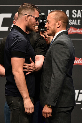 (L-R) Opponents Michael Bisping and Georges St-Pierre face off during the UFC 217 news conference inside T-Mobile Arena on October 6, 2017 in Las Vegas, Nevada. (Photo by Jeff Bottari/Zuffa LLC)