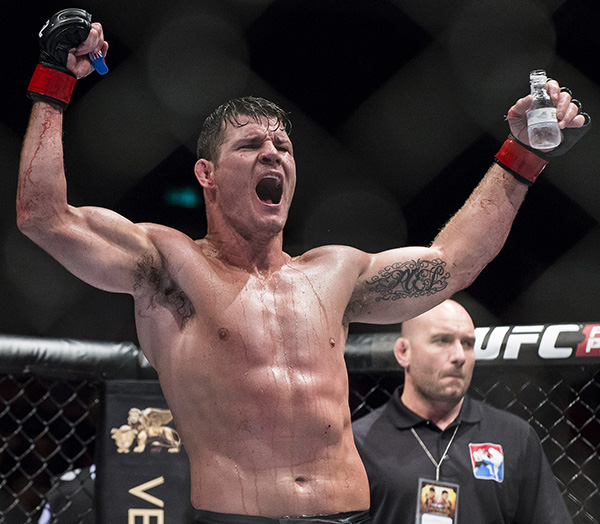 Michael Bisping celebrates after winning his middleweight fight against Cung Le of USA during the UFC Fight Night at The Venetian Macao Cotai Arena on August 23, 2014 in Macau, China. (Photo by Victor Fraile/Getty Images)