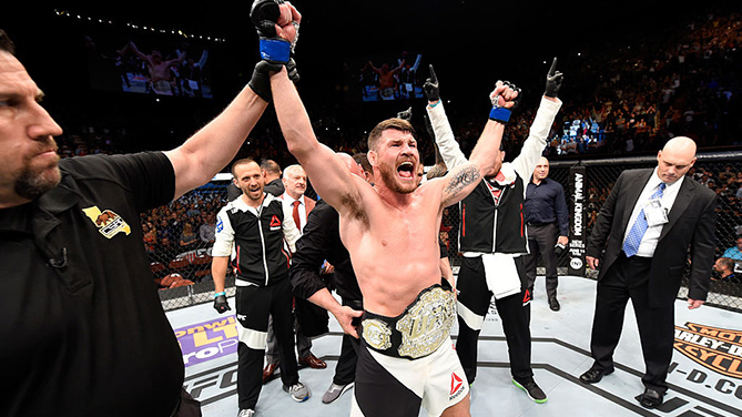 INGLEWOOD, CA - JUNE 04: Michael Bisping celebrates after his first round knockout win against Luke Rockhold in their UFC middleweight championship bout during the UFC 199 event at The Forum. (Photo by Josh Hedges/Zuffa LLC)