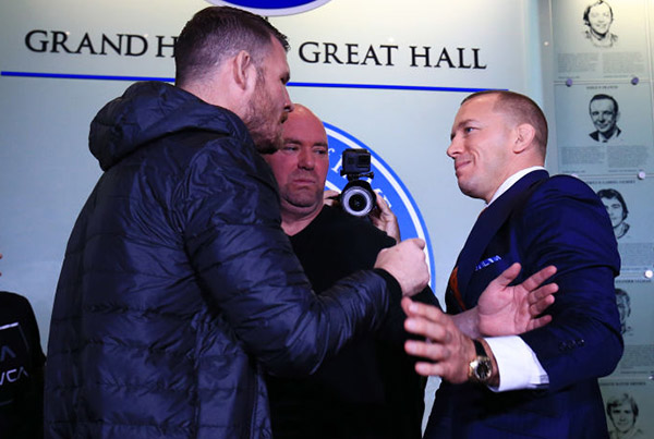 <a href='../fighter/Michael-Bisping'>Michael Bisping</a> and <a href='../fighter/Georges-St-Pierre'>Georges St-Pierre</a> face off following the UFC 217 press conference with Dana White at the Hockey Hall of Fame on October 13, 2017 in Toronto, Canada.  (Photo by Vaughn Ridley/Zuffa LLC)