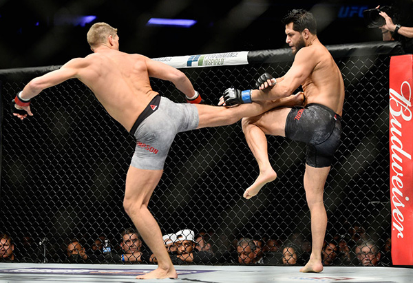 NEW YORK, NY - NOVEMBER 04: <a href='../fighter/Stephen-Thompson'>Stephen Thompson</a> lands a kick against <a href='../fighter/Jorge-Masvidal'>Jorge Masvidal</a> in their welterweight bout during the UFC 217 event at Madison Square Garden on November 4, 2017 in New York City. (Photo by Jeff Bottari/Zuffa LLC)