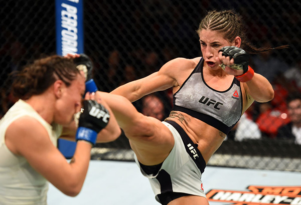 <a href='../fighter/Tecia-Torres'>Tecia Torres</a> kicks <a href='../fighter/michelle-waterson'>Michelle Waterson</a> in their women's strawweight bout during the UFC 218 event inside Little Caesars Arena on December 02, 2017 in Detroit, Michigan. (Photo by Josh Hedges/Zuffa LLC)