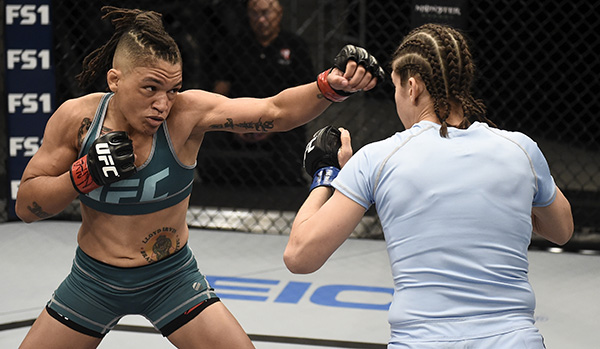 Sijara Eubanks punches Roxanne Modafferi during their semifinal fight in The Ultimate Fighter