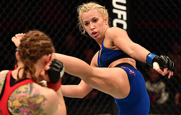 Amanda Cooper kicks <a href='../fighter/anna-elmose'>Anna Elmose</a>at UFC Fight Night Belfast on November 19, 2016. (Photo by Brandon Magnus/Zuffa LLC)
