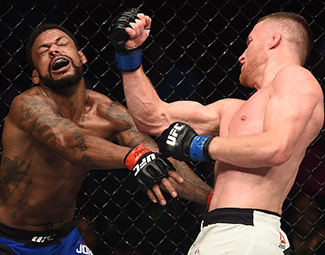 Justin Gaethje punches Michael Johnson during <a href='../event/The-Ultimate-Fighter-T-Rampage-vs-T-Forrest-Finale'><a href='../event/The-Ultimate-Fighter-Finale-Team-Nog-vs-Team-Mir'><a href='../event/The-Ultimate-Fighter-Team-Liddell-vs-Team-Ortiz-FINALE'><a href='../event/TUF13-finale'><a href='../event/the-ultimate-fighter-a-champion-will-be-crowned'>The Ultimate Fighter Finale </a></a></a></a></a>at T-Mobile Arena on July 7, 2017 in Las Vegas, Nevada. (Photo by Brandon Magnus/Zuffa LLC)