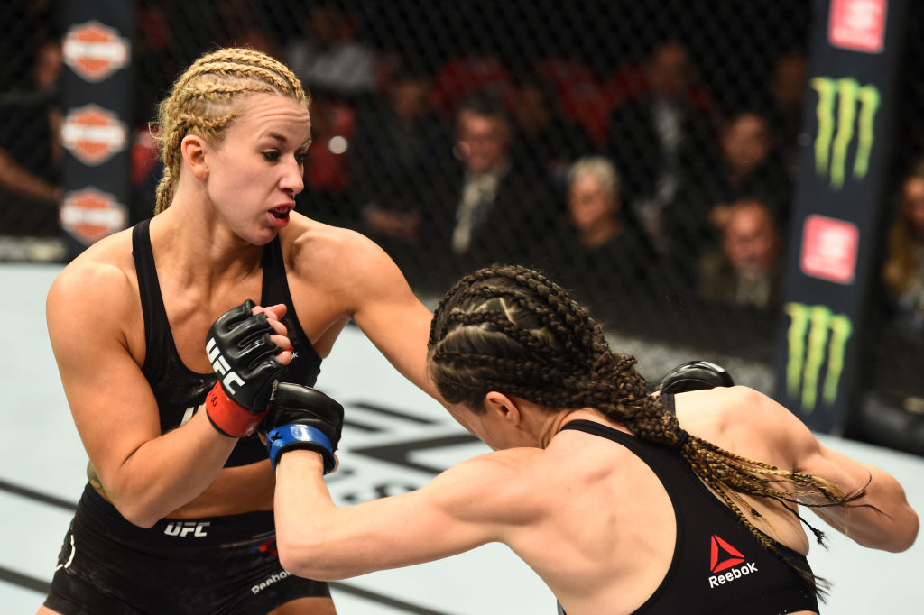 DETROIT, MI - DECEMBER 02: (L-R) Amanda Cooper punches Angela Magana in their women's strawweight bout during the UFC 218 event inside Little Caesars Arena on December 02, 2017 in Detroit, Michigan. (Photo by Josh Hedges/Zuffa LLC)