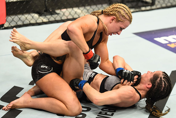(L-R) <a href='../fighter/amanda-cooper'>Amanda Cooper</a> punches <a href='../fighter/Angela-Magana'>Angela Magana</a> in their women's strawweight bout during the UFC 218 event inside Little Caesars Arena on December 02, 2017 in Detroit, Michigan. (Photo by Josh Hedges/Zuffa LLC)