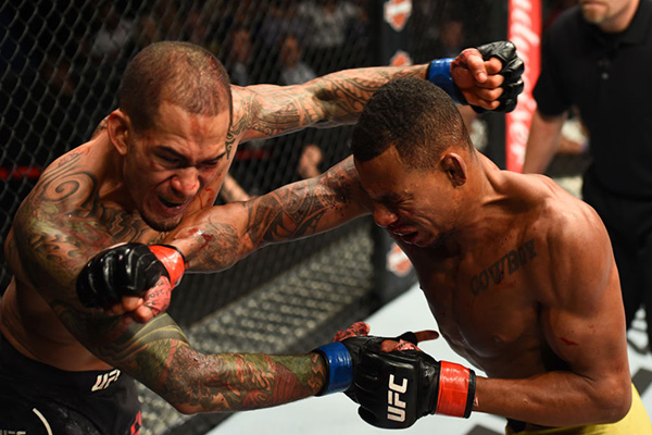 (R-L) <a href='../fighter/alex-oliveira'>Alex Oliveira</a> trades punches with <a href='../fighter/Yancy-Medeiros'>Yancy Medeiros</a> in their welterweight bout during the UFC 218 event inside Little Caesars Arena on December 02, 2017 in Detroit, Michigan. (Photo by Josh Hedges/Zuffa LLC)