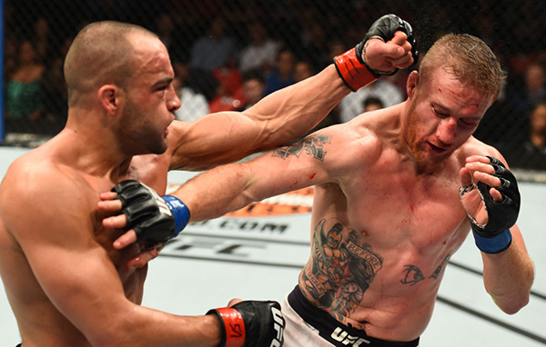 (L-R) <a href='../fighter/eddie-alvarez'>Eddie Alvarez</a> punches <a href='../fighter/Justin-Gaethje'>Justin Gaethje</a> in their lightweight bout during the UFC 218 event inside Little Caesars Arena on December 02, 2017 in Detroit, Michigan. (Photo by Josh Hedges/Zuffa LLC)
