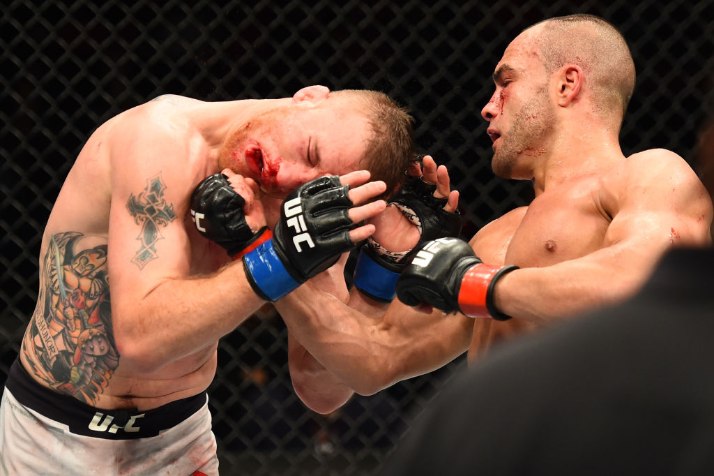 <a href='../fighter/eddie-alvarez'>Eddie Alvarez</a> punches <a href='../fighter/Justin-Gaethje'>Justin Gaethje</a> during their lightweight bout at UFC 218