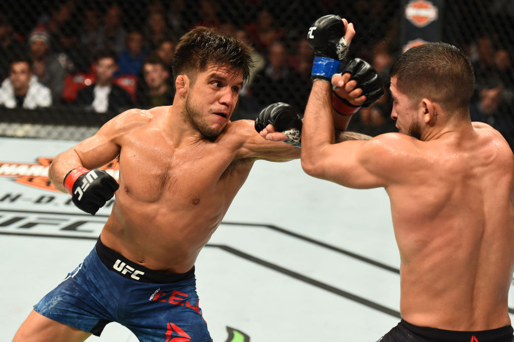 DETROIT, MI - DECEMBER 02:  (L-R) Henry Cejudo punches Sergio Pettis in their flyweight bout during the UFC 218 event inside Little Caesars Arena on December 02, 2017 in Detroit, Michigan. (Photo by Josh Hedges/Zuffa LLC)