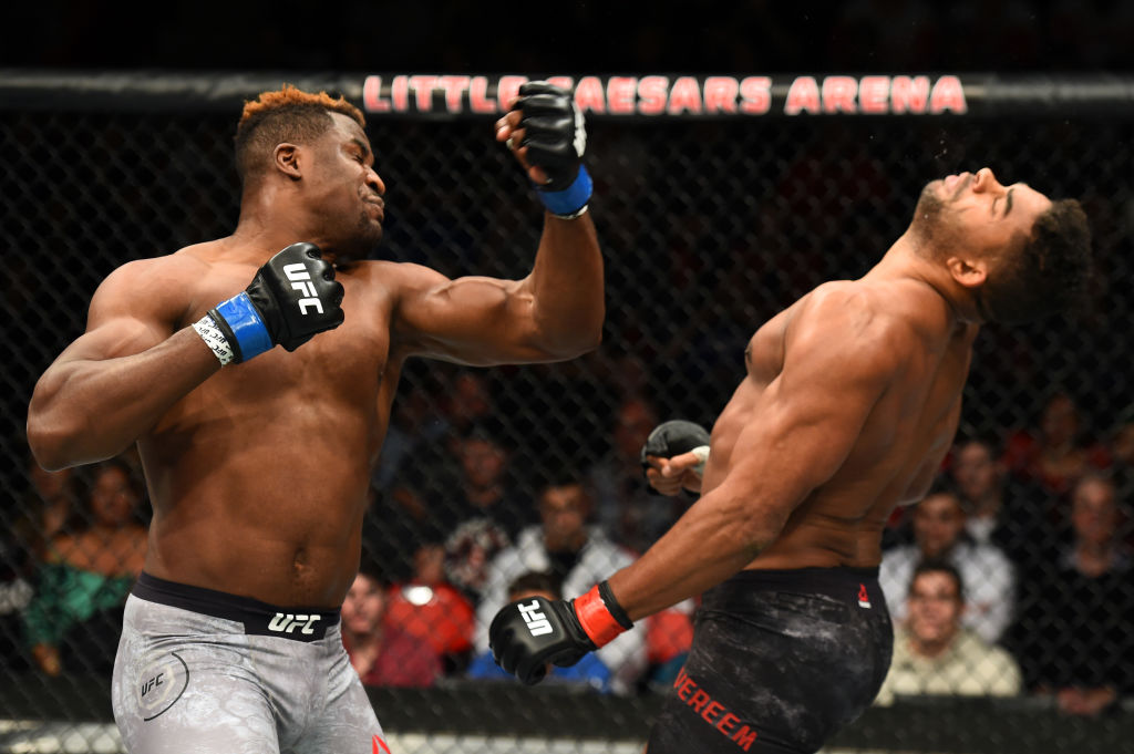 (L-R) Francis Ngannou of punches Alistair Overeem UFC 218 on December 02, 2017 in Detroit, MI (Photo by Josh Hedges/Zuffa LLC)