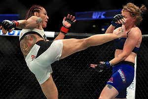Cris Cyborg of Brazil (L) fights Tonya Evinger during UFC 214 on July 29, 2017 in Anaheim, CA. (Photo by Sean M. Haffey/Getty Images)