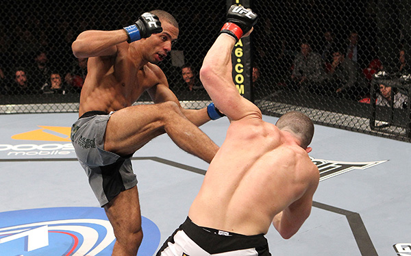 Edson Barboza lands a kick to the stomach against Mike Lullo during their Lightweight bout part of UFC 123 at the Palace of Auburn Hills on November 20, 2010 in Auburn Hills, Michigan. (Photo by Josh Hedges/Zuffa LLC)