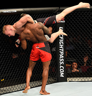 (R-L) Marc Diakiese takes down Lukasz Sajewski o during the UFC 204 Fight Night at the Manchester Evening News Arena on October 8, 2016 in Manchester, England. (Photo by Josh Hedges/Zuffa LLC)