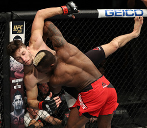 Marc Diakiese of England takes down Frankie Perez during the UFC Fight Night event at the Times Union Center on December 9, 2016 in Albany, New York. (Photo by Patrick Smith/Zuffa LLC)