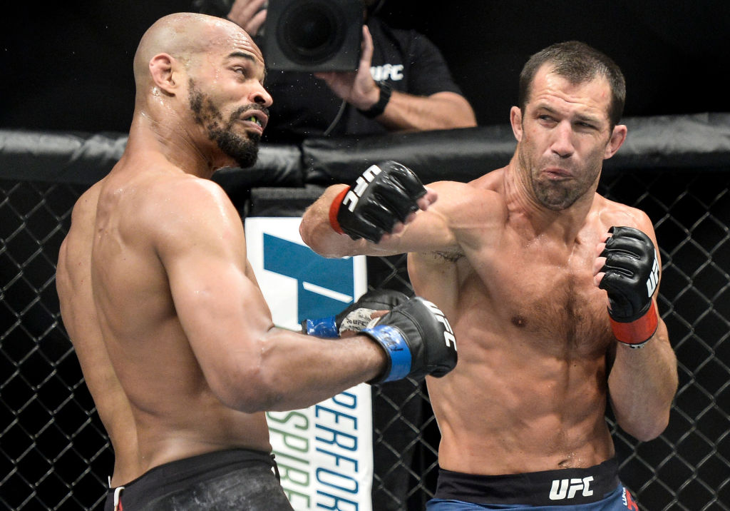 PITTSBURGH, PA - SEPTEMBER 16:  (R-L) Luke Rockhold punches David Branch in their middleweight bout during the UFC Fight Night event inside the PPG Paints Arena on September 16, 2017 in Pittsburgh, Pennsylvania. (Photo by Brandon Magnus/Zuffa LLC)