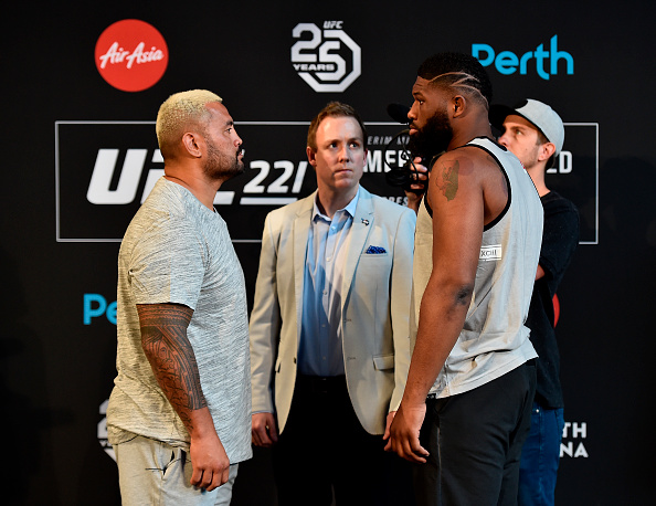 PERTH, AUSTRALIA - FEBRUARY 07: (L-R) <a href='../fighter/mark-hunt'>Mark Hunt</a> of New Zealand and <a href='../fighter/Curtis-Blaydes'>Curtis Blaydes</a> face off during the UFC 221 Press Conference at Perth Arena on February 7, 2018 in Perth, Australia. (Photo by Jeff Bottari/Zuffa LLC/Zuffa LLC via Getty Images)