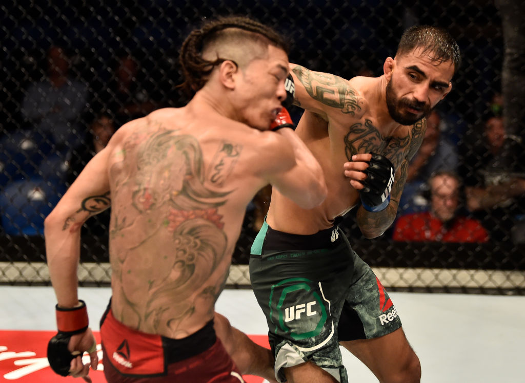 FEBRUARY 11: (R-L) Jose Quinonez of Mexico punches Teruto Ishihara of Japan in their bantamweight bout during the UFC 221 event at Perth Arena on February 11, 2018 in Perth, Australia. (Photo by Jeff Bottari/Zuffa LLC)