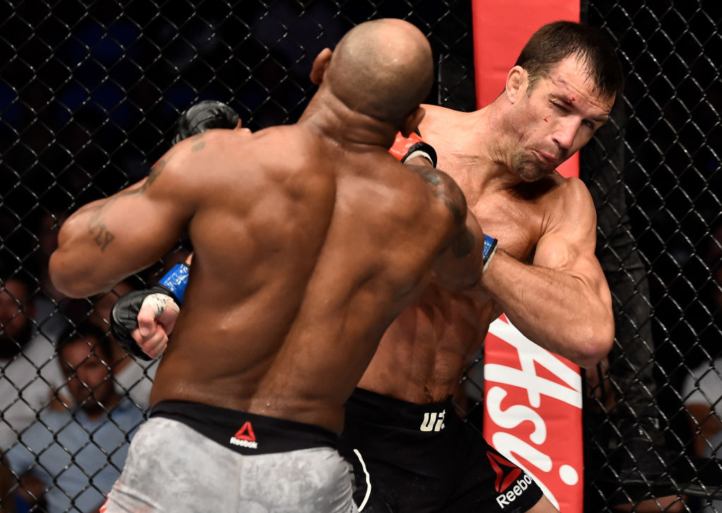 PERTH, AUSTRALIA - FEBRUARY 11: (L-R) Yoel Romero of Cuba punches Luke Rockhold in their interim middleweight title bout during the UFC 221 event at Perth Arena on February 11, 2018 in Perth, Australia. (Photo by Jeff Bottari/Zuffa LLC)