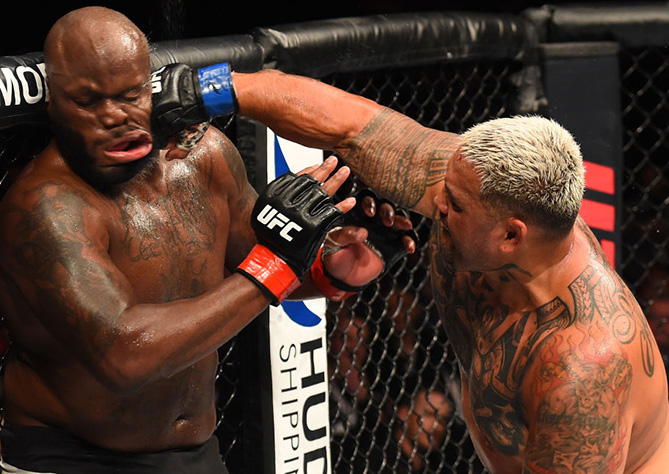 <a href='../fighter/mark-hunt'>Mark Hunt</a> punches <a href='../fighter/Derrick-Lewis'>Derrick Lewis</a> during the <a href='../event/UFC-Silva-vs-Irvin'>UFC Fight Night </a>event in Auckland, New Zealand. (Photo by Josh Hedges/Zuffa LLC)