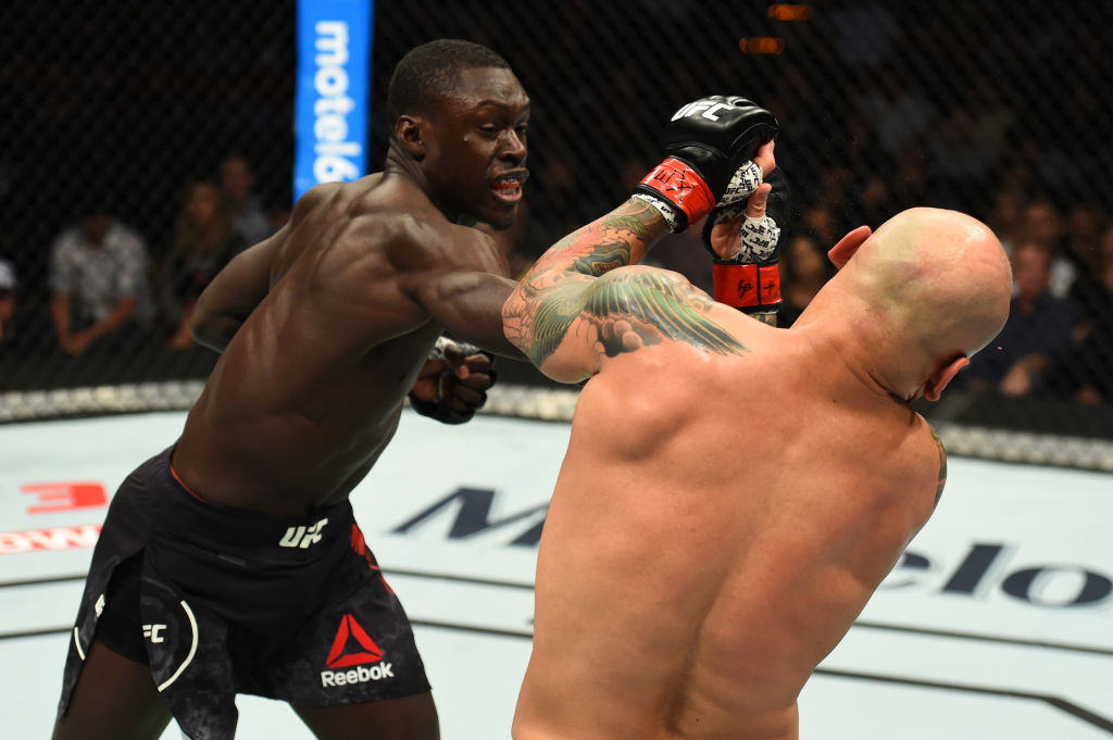 Curtis Millender (L) punches Thiago Alves during the UFC Fight Night event at Frank Erwin Center on February 18, 2018 in Austin, Texas. (Photo by Josh Hedges/Zuffa LLC)