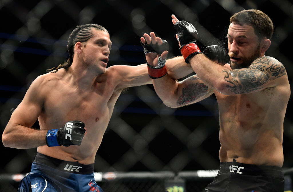 Brian Ortega punches <a href='../fighter/Frankie-Edgar'>Frankie Edgar</a> during UFC 222 on March 3, 2018. (Photo by Brandon Magnus/Zuffa LLC)