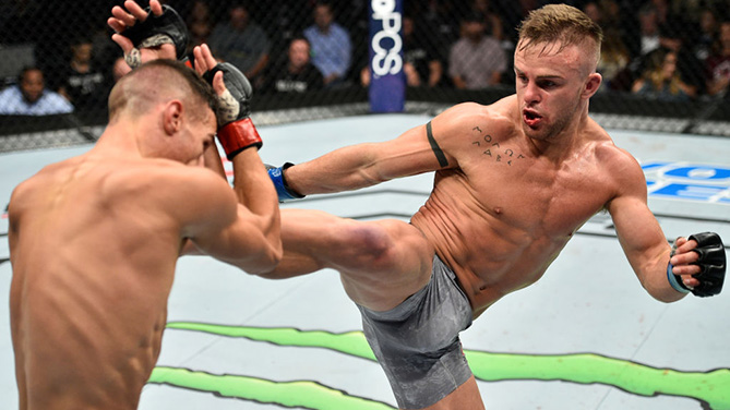 LAS VEGAS, NV - OCTOBER 07: (R-L) Cody Stamann kicks Tom Duquesnoy of France in their bantamweight bout during the UFC 216 event inside T-Mobile Arena on October 7, 2017 in Las Vegas, Nevada. (Photo by Jeff Bottari/Zuffa LLC)