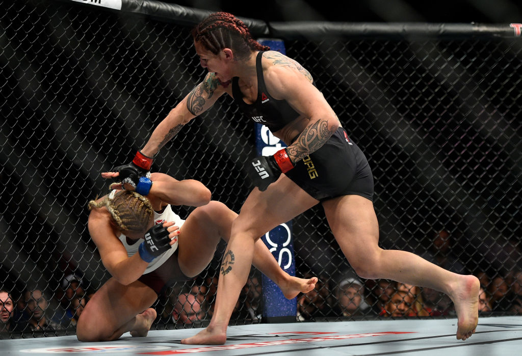 Cris Cyborg punches <a href='../fighter/Yana-Kunitskaya'>Yana Kunitskaya</a> during UFC 222 on March 3, 2018 in Las Vegas, NV. (Photo by Brandon Magnus/Zuffa LLC)