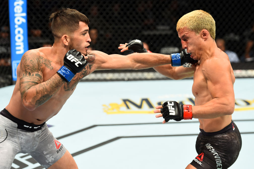 CHICAGO, ILLINOIS - JUNE 09:  (L-R) Sergio Pettis punches Joseph Benavidez in their flyweight fight during the UFC 225 event at the United Center on June 9, 2018 in Chicago, Illinois. (Photo by Josh Hedges/Zuffa LLC/Zuffa LLC via Getty Images)