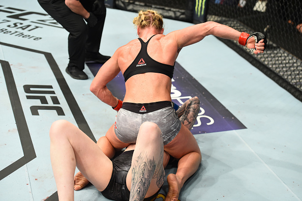CHICAGO, ILLINOIS - JUNE 09:  (L-R) Holly Holm controls the body of Megan Anderson of Australia in their women's featherweight fight during the UFC 225 event at the United Center on June 9, 2018 in Chicago, Illinois. (Photo by Josh Hedges/Zuffa LLC/Zuffa LLC via Getty Images)