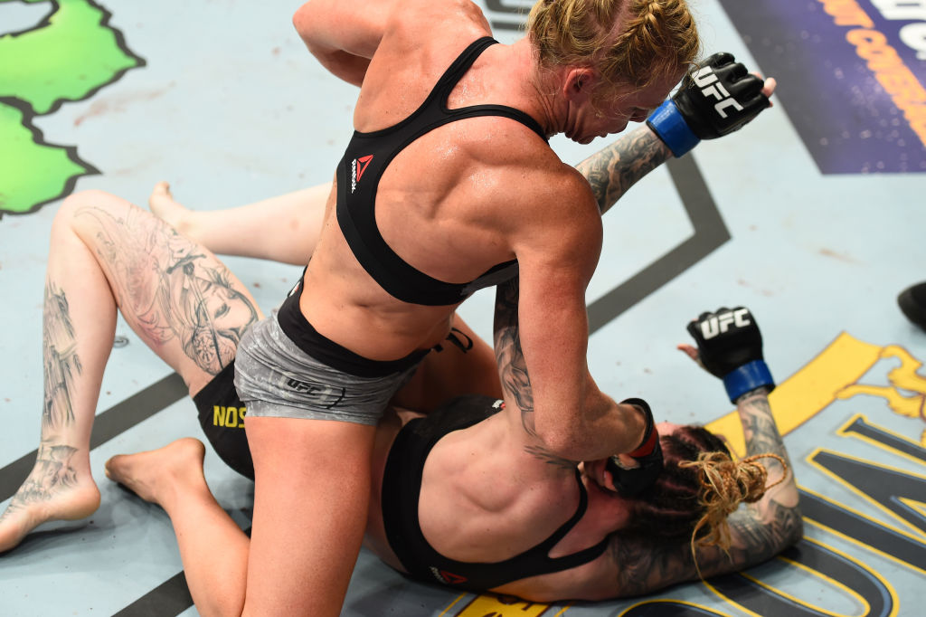 Holly Holm punches <a href='../fighter/megan-anderson'>Megan Anderson</a> at UFC 225 (Photo by Josh Hedges/Zuffa LLC)