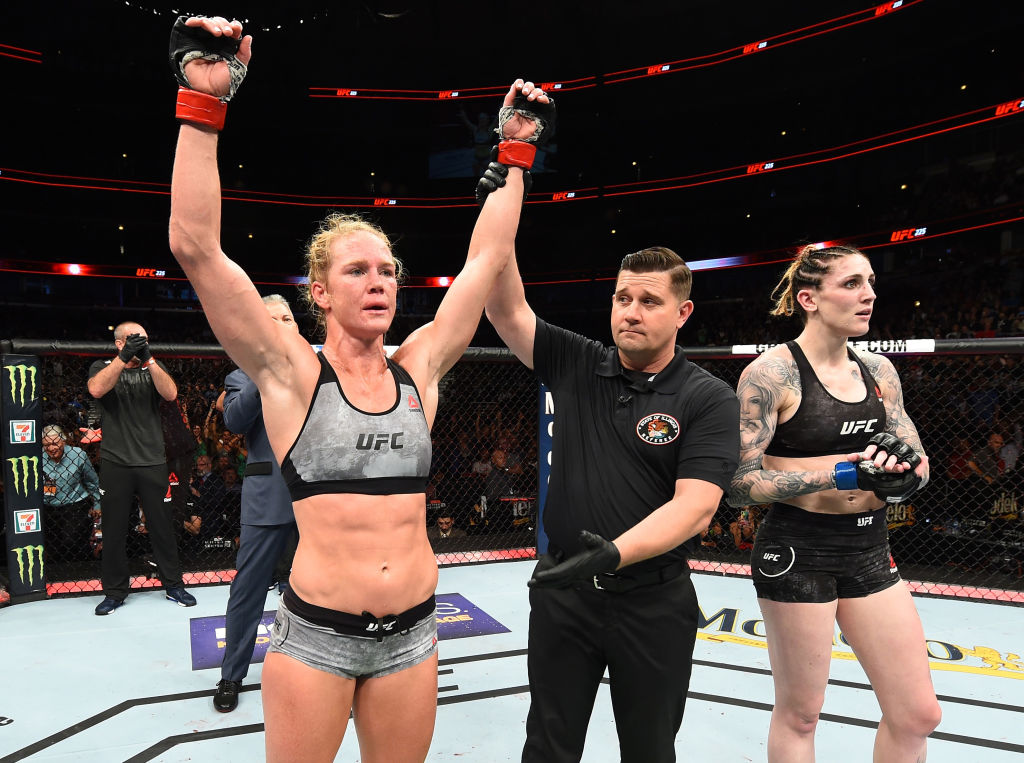 CHICAGO, ILLINOIS - JUNE 09:  (L-R) Holly Holm celebrates after defeating Megan Anderson of Australia in their women's featherweight fight during the UFC 225 event at the United Center on June 9, 2018 in Chicago, Illinois. (Photo by Josh Hedges/Zuffa LLC/Zuffa LLC via Getty Images)