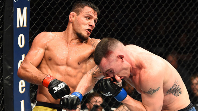 CHICAGO, ILLINOIS - JUNE 09:  (L-R) Rafael Dos Anjos of Brazil punches Colby Covington in their interim welterweight title fight during the UFC 225 event at the United Center on June 9, 2018 in Chicago, Illinois. (Photo by Josh Hedges/Zuffa LLC/Zuffa LLC via Getty Images)