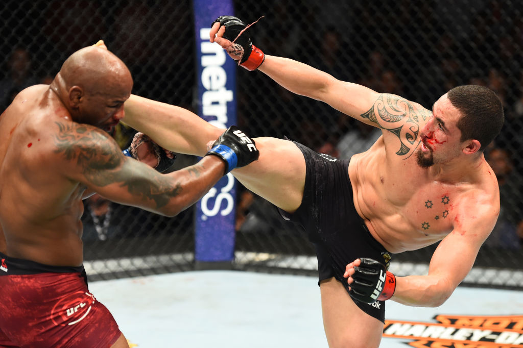 Robert Whittaker lands a kick to the head of <a href='../fighter/Yoel-Romero'>Yoel Romero</a> at UFC 225  (Photo by Josh Hedges/Zuffa LLC)