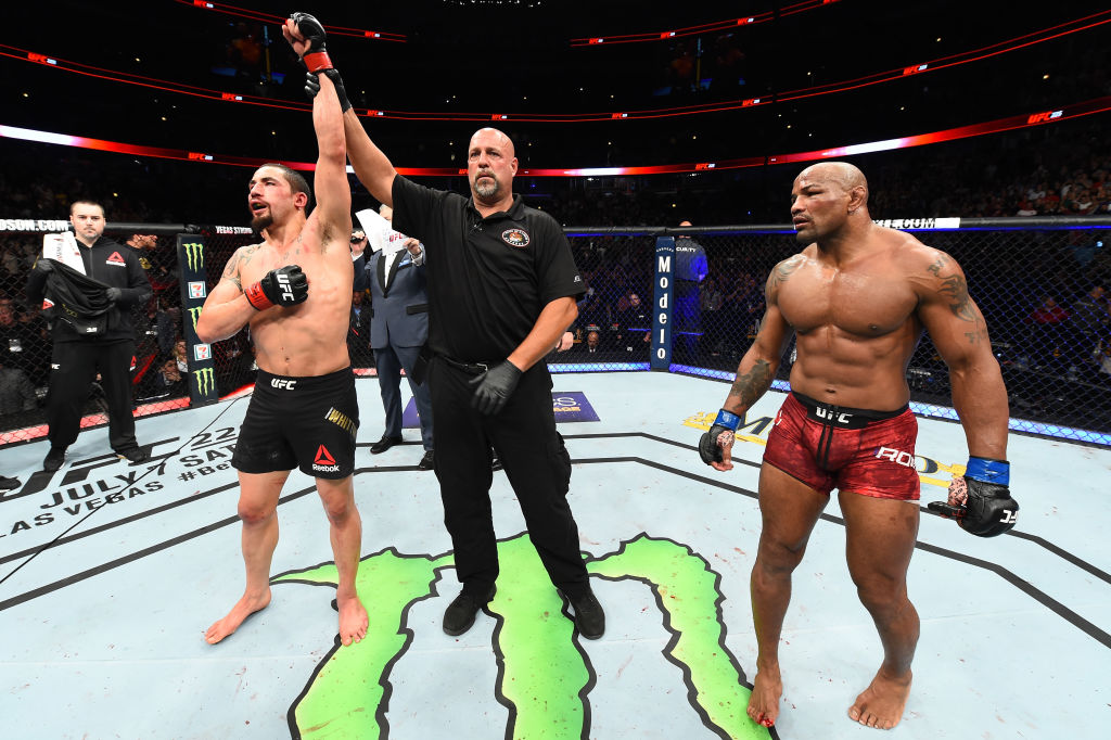 CHICAGO, ILLINOIS - JUNE 09:  (L-R) Robert Whittaker of New Zealand reacts after defeating Yoel Romero of Cuba in their middleweight fight during the UFC 225 event at the United Center on June 9, 2018 in Chicago, Illinois. Whittaker won by split decision. (Photo by Josh Hedges/Zuffa LLC/Zuffa LLC via Getty Images)