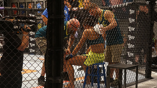 Dustin Ortiz helps corner Jessica Penne
