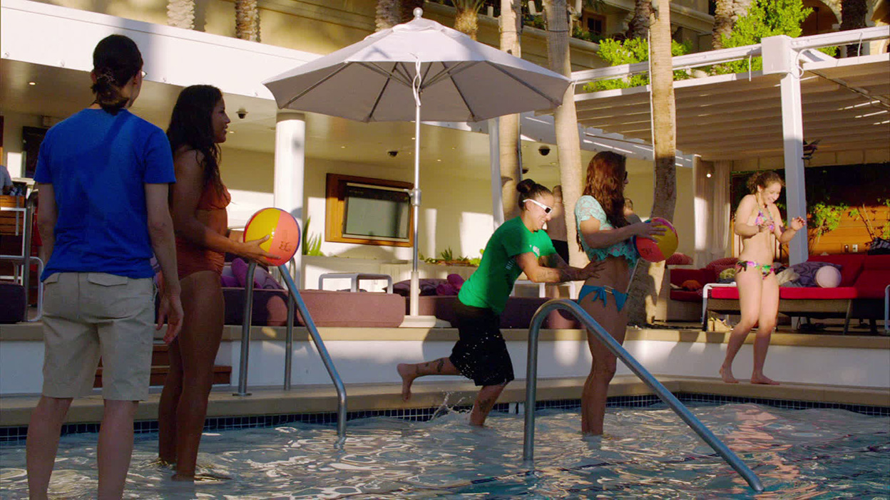Raquel gives Miesha a light push into the pool
