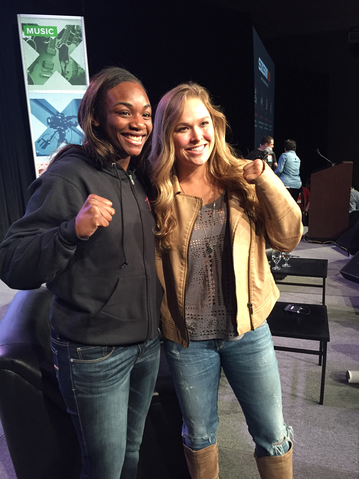 Olympic gold medalist Claressa Shields (L) and Ronda Rousey
