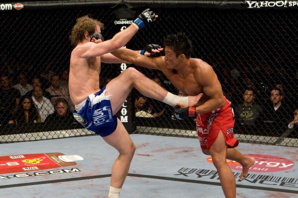 Akiyama lands a left against Belcher