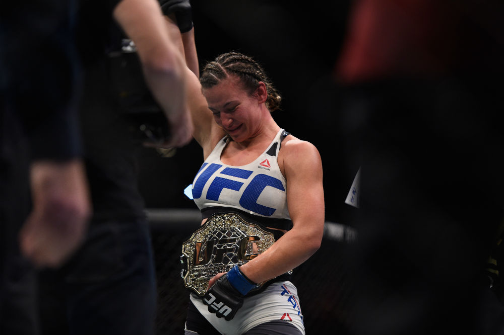 Miesha Tate achieved her dream at UFC 196 and became the UFC women's bantamweight champion when she upset <a href='../fighter/holly-holm'>Holly Holm</a>