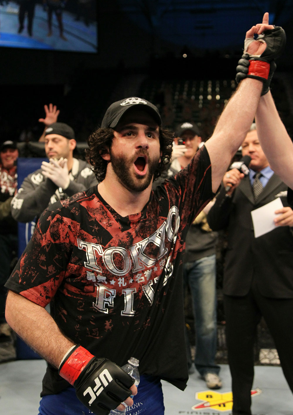 Charlie Brenneman celebrates his win over Alves.